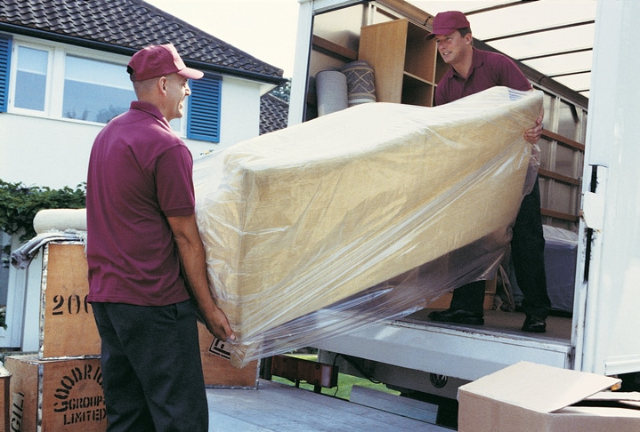 Movers Unloading Moving Van